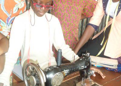Student Practising  using  Sewing Maching During Summer Coaching